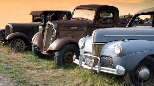 Antique trucks and cars along the road in Montana